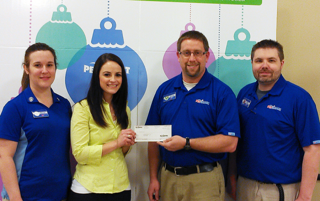 Jessica Marabella accepts a $2,000 donation on behalf of PAWS of CNY from PetSmart Store Manager Richard Merrill, Operations Manager Tom Lebeau and PAWS volunteer and PetSmart trainer, Melanie Hoover.
